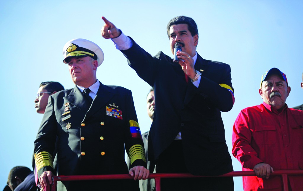 Venezuela's Vice President Nicolas Maduro speaks from the top of a truck to the crowd gathered outside the military academy where the body of Venezuela's late President Hugo Chavez is lying in state in Caracas, Venezuela, Thursday. (AP Photo/Rodrigo Abd)