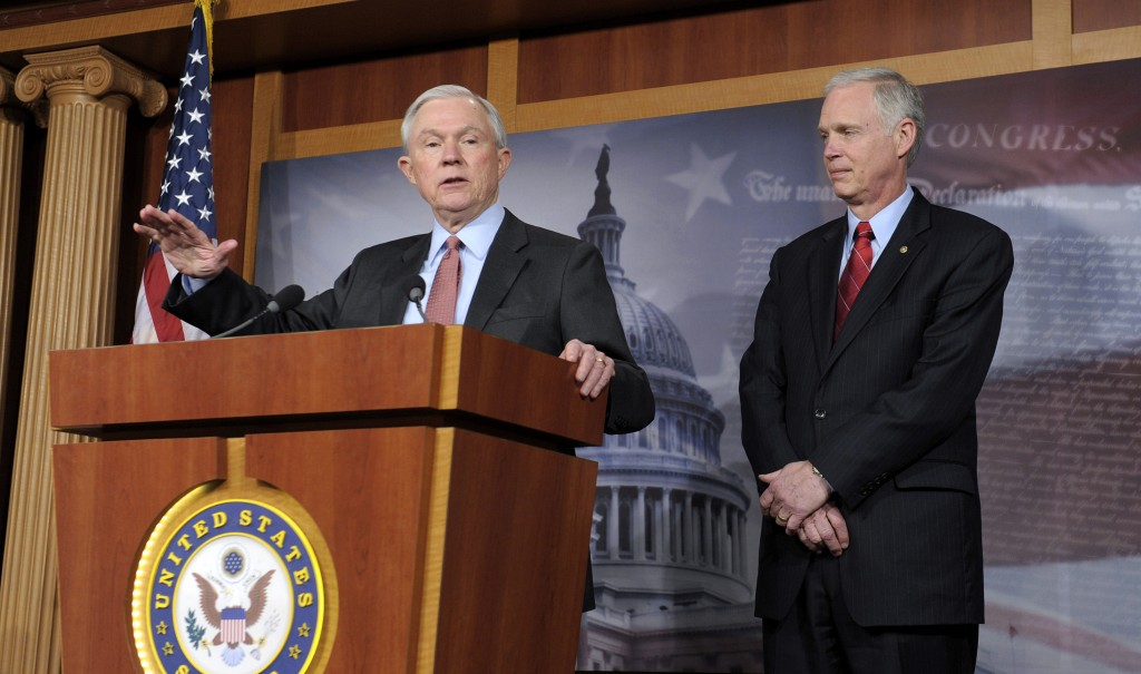 Sen. Jeff Sessions (R-Ala.) (L) accompanied by Sen. Ron Johnson (R-Wis.), gestures during a new conference on Capitol Hill in Washington, Thursday to discuss the Democratic budget. (AP Photo/Susan Walsh)