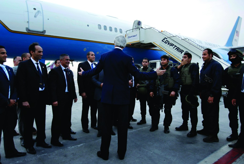 U.S. Secretary of State John Kerry says goodbye to staff and security personnel in Cairo, Egypt, en route to Riyadh, Saudi Arabia, Sunday. (AP Photo/Jacquelyn Martin, Pool)