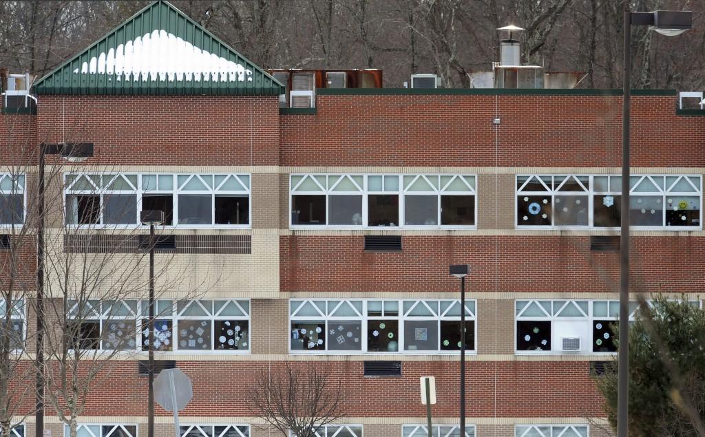 Snowflake artwork adorn windows at the new Sandy Hook Elementary School in Monroe, Conn. (AP Photo/Jessica Hill, File)