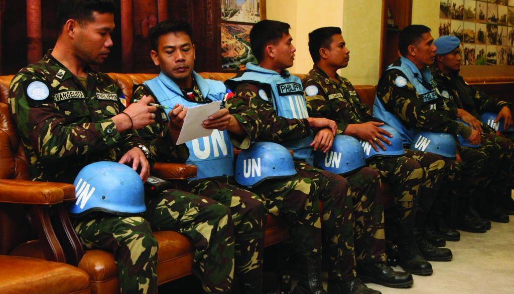 Filipino U.N. peacekeepers, part of a group of 21 held by rebels in southern Syria, wait to address a news conference at the headquarters of the General Command of the Jordanian Army in Amman on Sunday. (REUTERS)