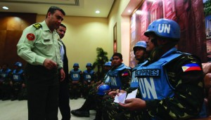 A Jordanian officer welcomes Filipino U.N. peacekeepers, part of a group of 21 peacekeepers held by rebels in southern Syria, at the headquarters of the General Command of the Jordanian Army in Amman on Sunday. (REUTERS)