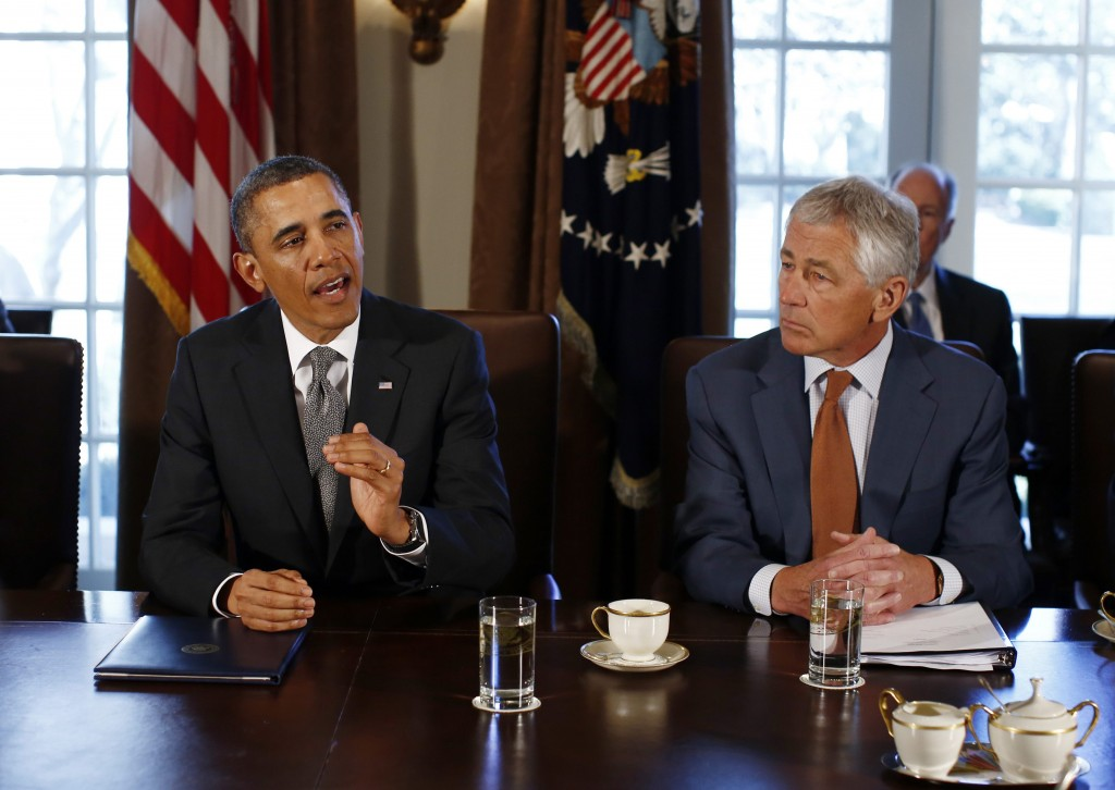 U.S. President Barack Obama (L) participates in his first cabinet meeting of his second term in the Cabinet Room of the White House Monday. Pictured with Obama is new Secretary of Defense Chuck Hagel. (REUTERS/Jason Reed)