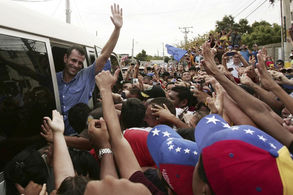 Venezuela's opposition leader and presidential candidate Henrique Capriles (L) greets supporters during a rally in Maracaibo monday. (REUTERS/Isaac Urrutia)