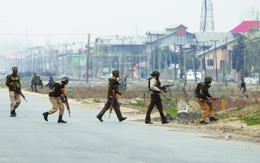 Indian paramilitary soldiers take their positions during a gunfight in Srinagar Wednesday. (REUTERS/Danish Ismail)