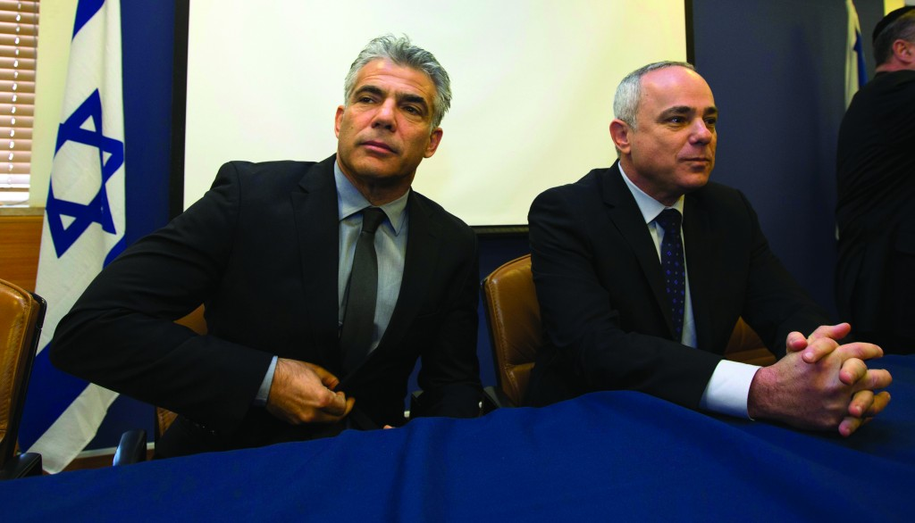 "Changeover: Outgoing Israeli Finance Minister Yuval Steinitz (R) sits alongside incoming Finance Minister Yair Lapid, who once told Prime Minister Binyamin Netanyahu he didn't ""know anything about economics."" (REUTERS)"