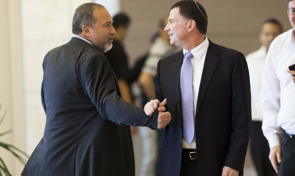 Head of the Yisrael Beiteinu party Avigdor Lieberman (L) shakes hands with MK Yuli Edelstein (R) at the Knesset, Thursday. Edelstein was nominated for Knesset speaker. (Flash90)