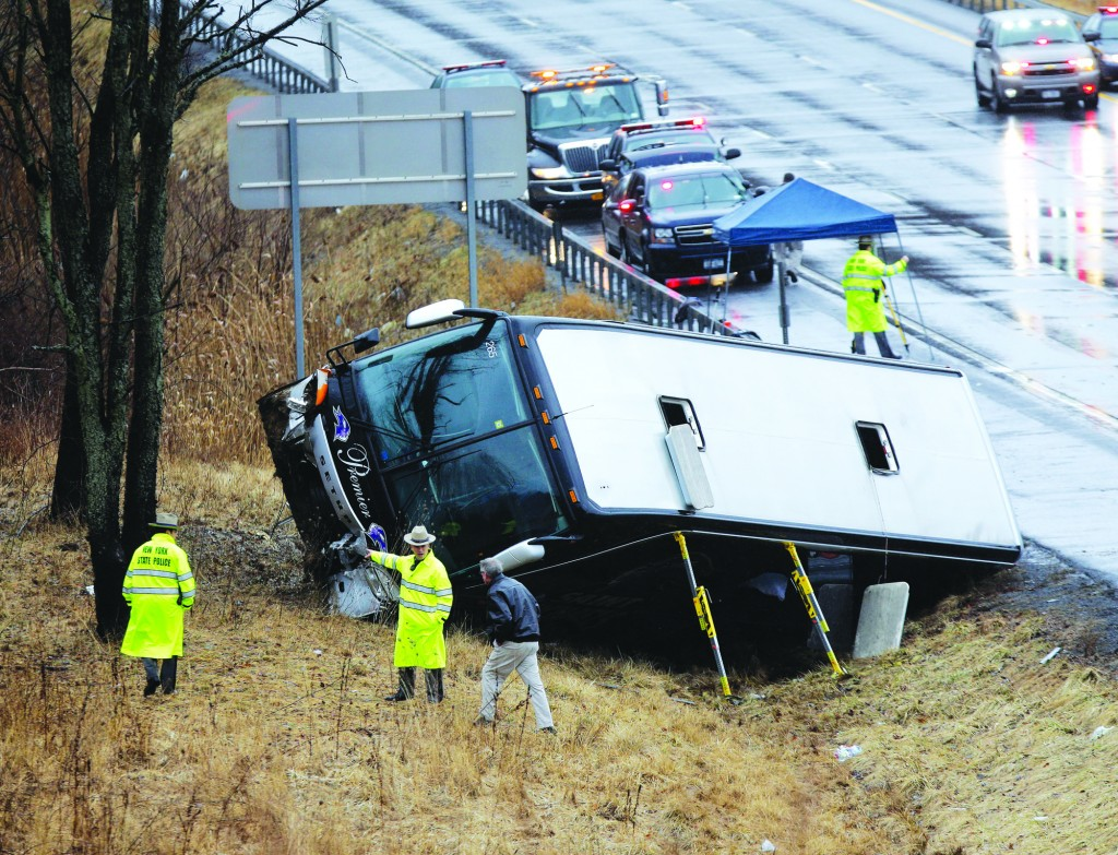Law enforcement personnel work at the scene of the bus crash Tuesday. (AP Photo/Mike Groll)