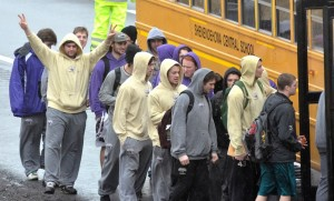 Team members board a school bus after the tour bus that  was carrying them crashed. (AP Photo/The Troy Record, Mike McMahon)
