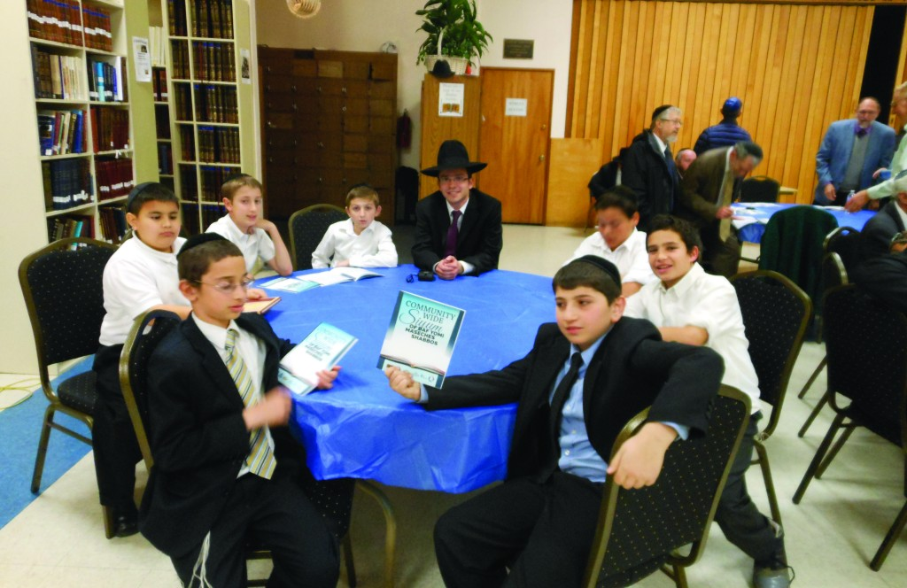 This past Motzoei Shabbos, close to 150 members of the greater Phoenix Community gathered together to celebrate the completion of maseches Shabbos and the commencement of maseches Eruvin by those who participate in the community-wide Daf Yomi shiurim. The siyum was held in Phoenix Hebrew Academy with the joint participation of Beth Joseph Congregation, Young Israel of Phoenix, Phoenix Community Kollel, Ohr HaTorah Congregation, and Congregation Ahavas Torah of Scottsdale. Rabbi Aryeh Bleeman of Phoenix Hebrew Academy enjoying the celebration together with his sixth-grade students at the Academy.