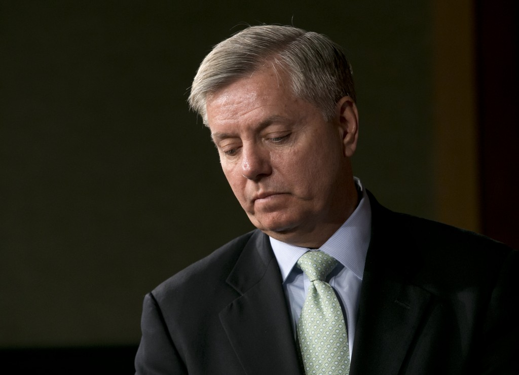 Sen. Lindsey Graham (R-S.C.) pauses during a news conference on Capitol Hill In Washington, Thursday, on the capture of Osama Bin Laden's son-in-law Sulaiman Abu Ghaith. (AP Photo/J. Scott Applewhite)