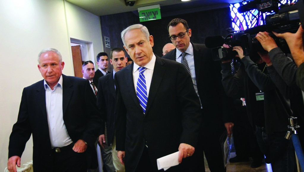 Israel's Prime Minister Binyamin Netanyahu (R) and Minister of Home Front Defense Avi Dichter arrive for the weekly Cabinet meeting on Sunday. (Flash90)