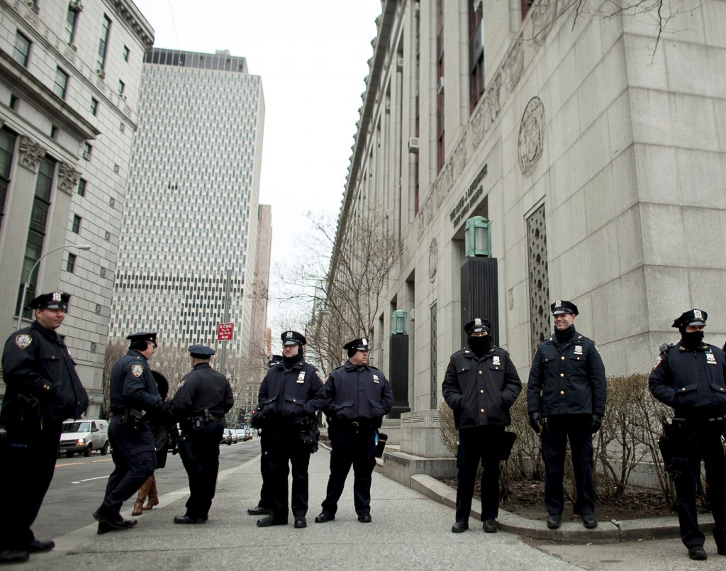 Police officers on Monday stand near a demonstration against the city's stop- and-frisk searches in lower Manhattan near Federal Court. (Allison Joyce/Getty Images)