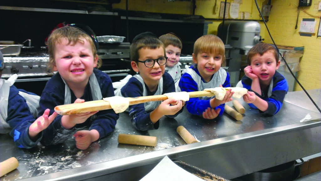 Kindergartners at Yeshivas Ruach Chaim in Brooklyn are hard at work in their 'in-house matzah bakery.'