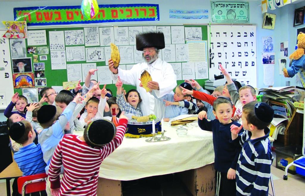Talmidim at Yeshivas Rebbeinu Chaim Berlin take part in a model Seder with their rebbi, Rabbi Mordechai Zev Jungreis, the Nikolsburger Rebbe.