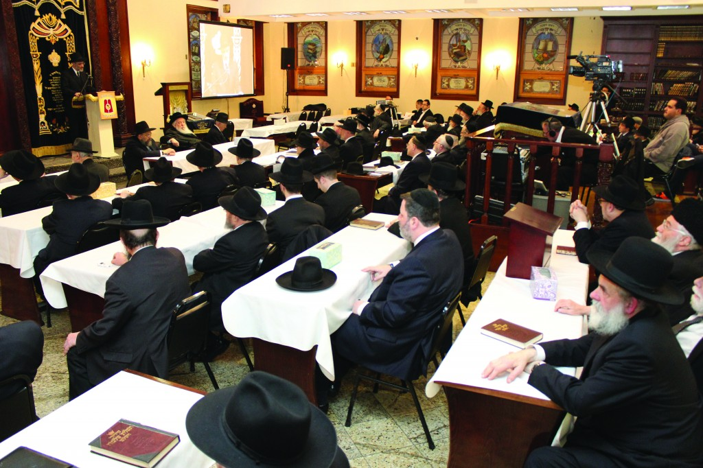 "On Thursday night, a kinus hesped v'zikaron was held l'iluy nishmas Rabbi Yosef Friedenson, z""l, editor of Dos Yiddishe Vort, who was niftar on Shabbos Parashas Zachor. The kinus took place in Boro Park at Agudath Israel Zichron Moshe. The Novominsker Rebbe, shlita (inset), Rosh Agudas Yisroel, addressed the gathering. The program also included Harav Dovid Olewski, Rosh Mesivta, Beis Yisroel of Ger, Rabbi Chaim Dovid Zweibel, Executive Vice President and Reb Yechiel Benzion Fishoff, Chairman Emeritus, Board of Trustees, Agudath Israel of America. (Photos: Hillel Engel)"