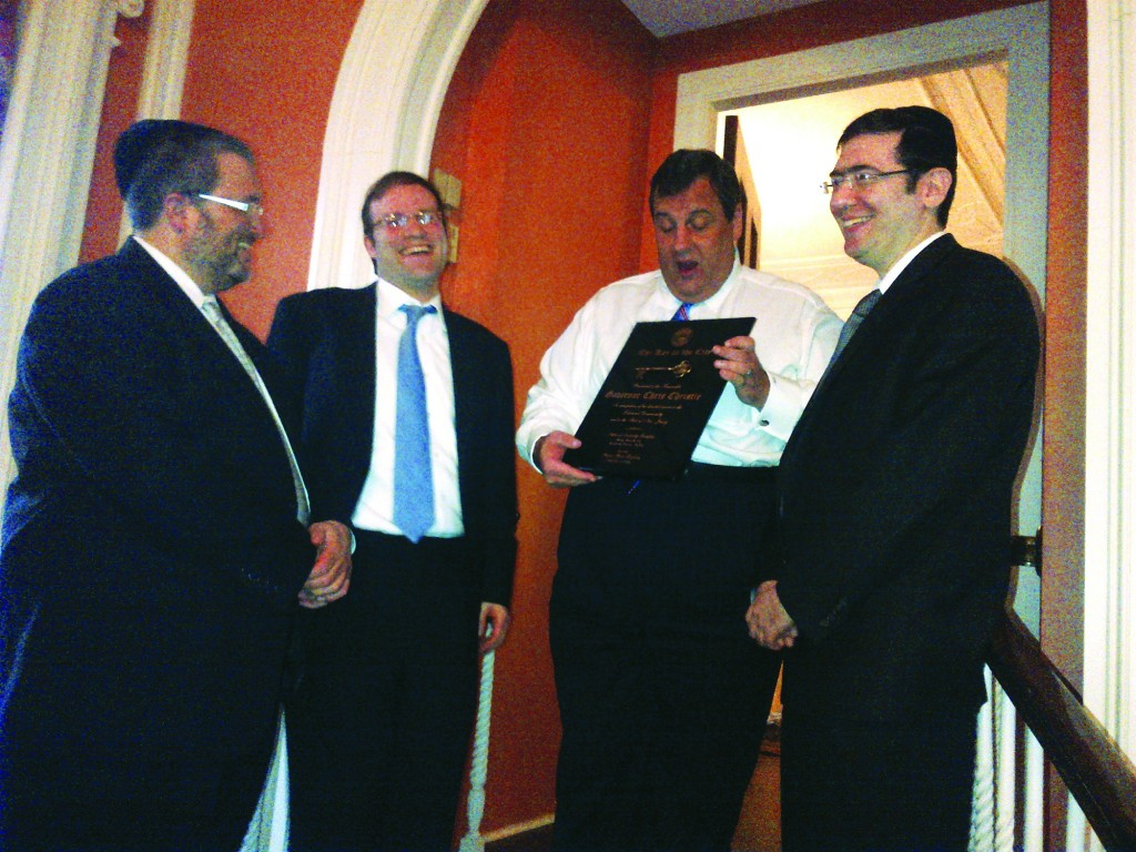 Lakewood Mayor Isaac Akerman presented Gov. Chris Christie with a 'Key to the Township,' as Menashe Miller (R) and Meir Lichtenstein (L) look on. (TheLakewoodScoop.com)