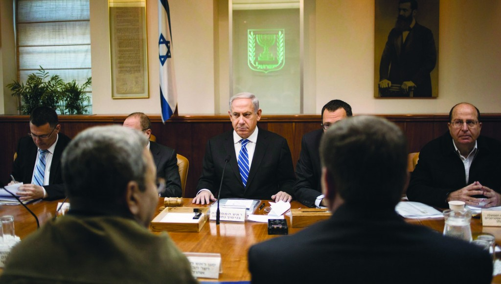 Israel's Prime Minister Netanyahu (C) at the weekly cabinet meeting. (REUTERS)