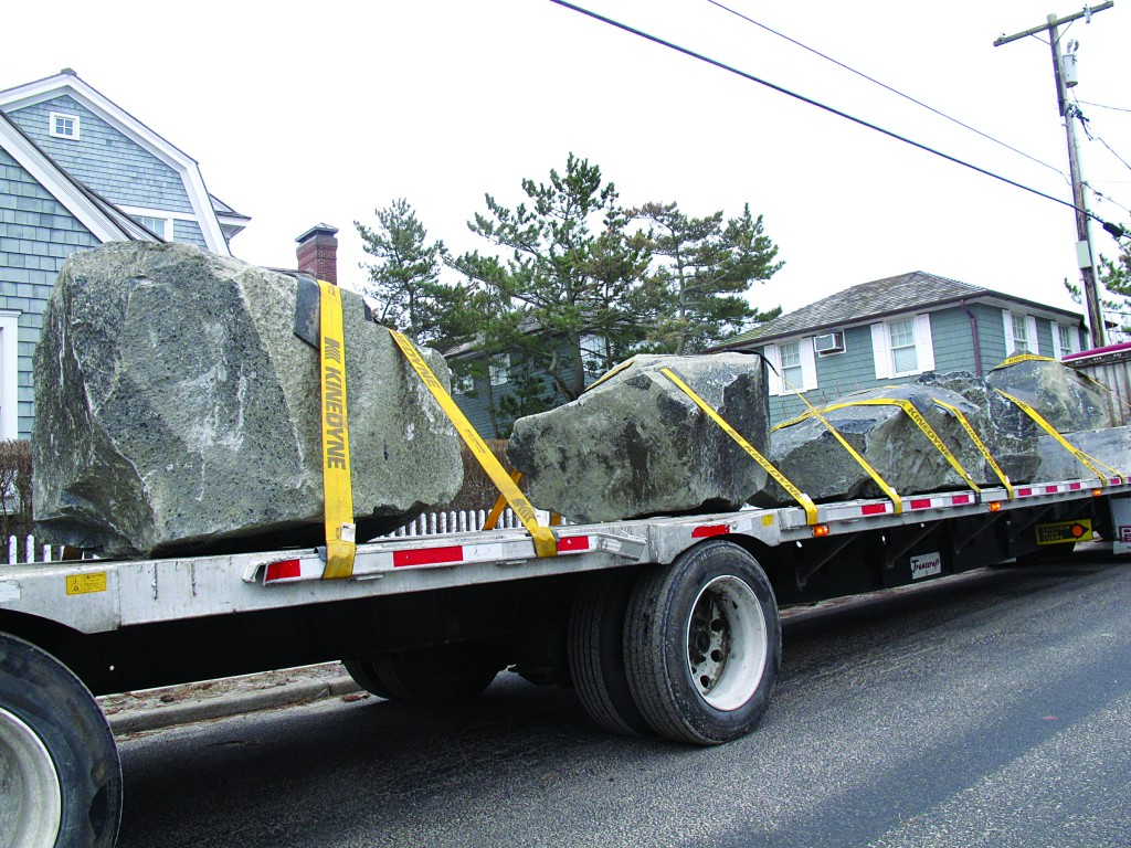 A truck carrying large boulders as part of a sea wall construction project arrives at the Bay Head N.J. beachfront on Wednesday. The rocks arrived at the start of a two-day winter storm that will bring strong winds, rain and snow to New jersey, possibly causing flooding in areas previously damaged by Superstorm Sandy. (AP Photo/Wayne Parry)