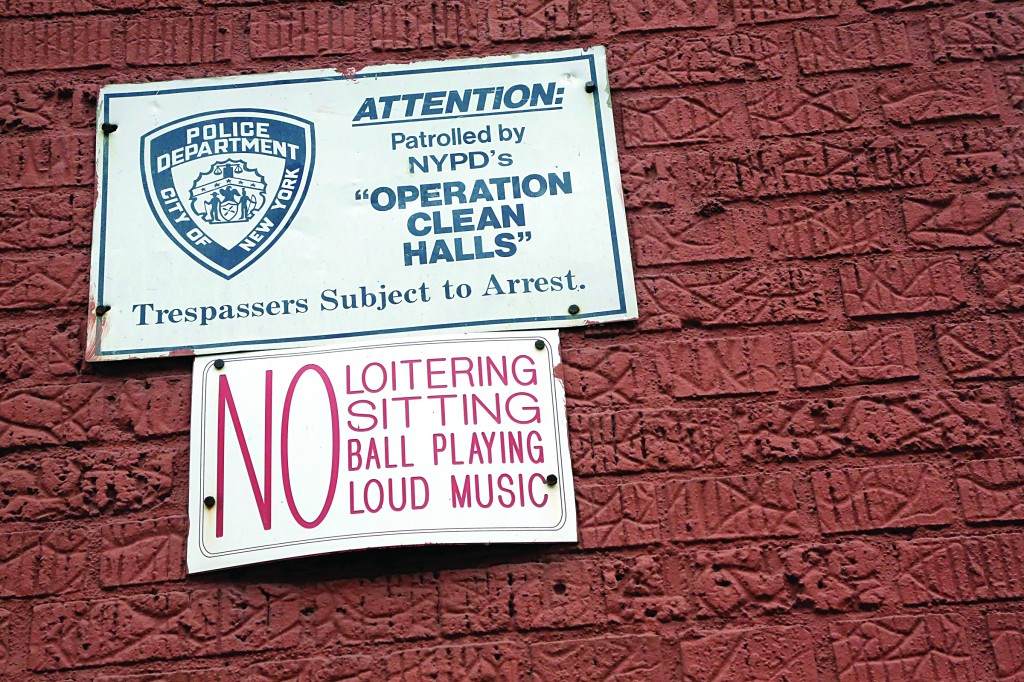 A sign is posted on the wall of a Bronx building last Wednesday. (AP Photo/Mary Altaffer)