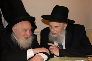 "Harav Shlomo Rothenberg, right, with his mechutan, ybl""c, Harav Yosef Rosenblum, last Pesach at a vort of their mutual grandson."