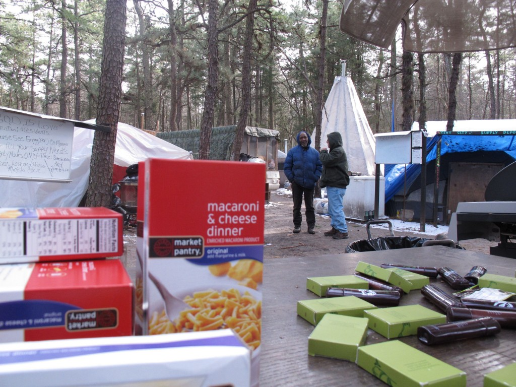Boxes of donated food sit on a table at Lakewood's Tent City last week. (AP Photo/Wayne Parry)