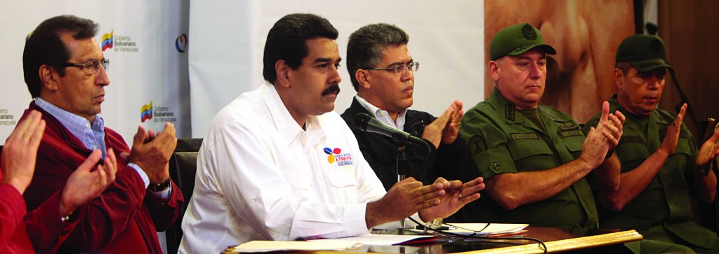 Venezuela's Vice President Nicolas Maduro, second from left, addresses the nation from Miraflores presidential palace during a meeting in Caracas, Venezuela, Tuesday, before Chavez's death. At left is Governor Adan Chavez, the older brother of President Hugo Chavez. Maduro met with top Venezuelan government ministers, the military high command and all 20 loyalist governors in Caracas. Foreign Minister Elias Jaua sits third from right. (AP Photo/Miraflores Presidential Press Office)