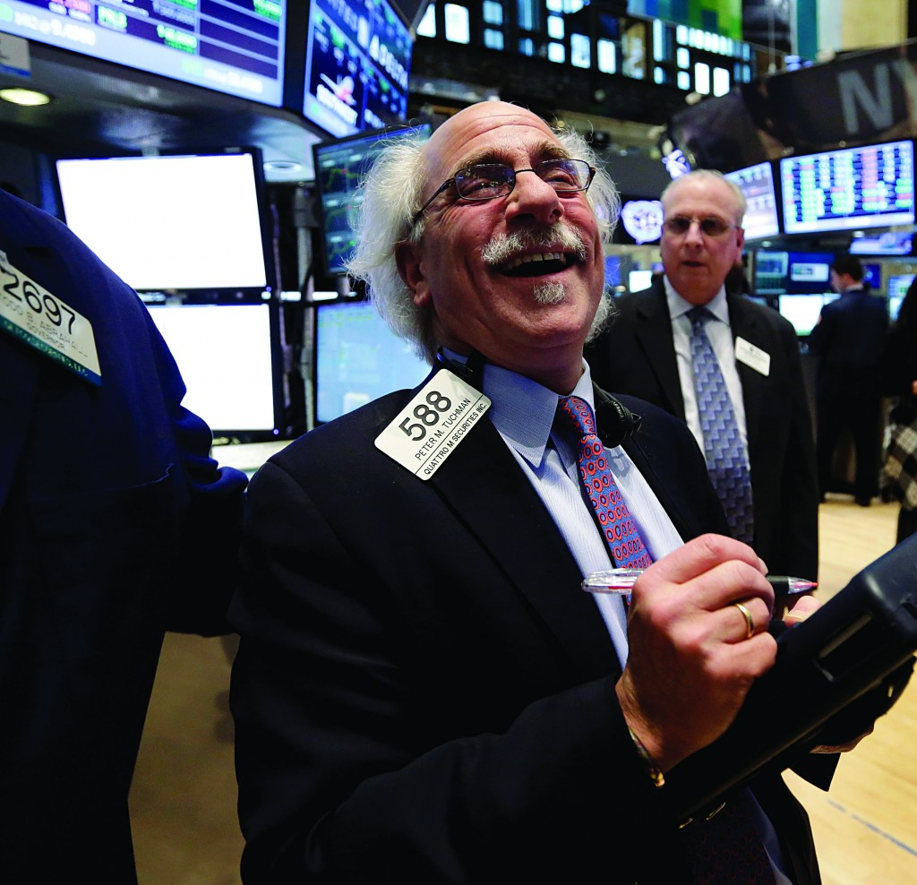 Trader Peter Tuchman smiles as he works on the floor of the New York Stock Exchange on Tuesday. (AP Photo/Richard Drew)
