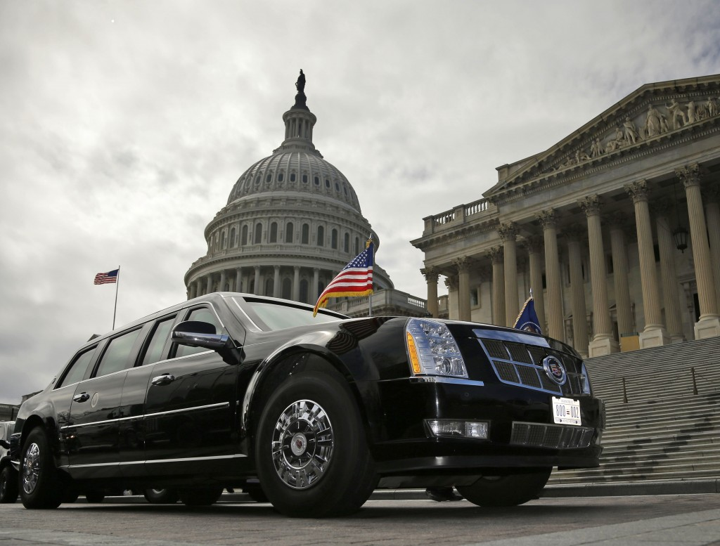 President Barack Obama's motorcade vehicle sits in front of the U.S. Senate side of the U.S. Capitol in Washington, Tuesday. Obama was inside meeting with the Senate Democratic Caucus trying to find solutions to the government's fiscal cutbacks. (REUTERS/Larry Downing)