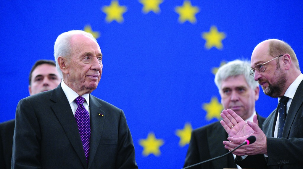 Israeli President Shimon Peres (L) is applauded by European Parliament President Martin Schulz (R), as he arrives in the hemicycle of the European Parliament in Strasbourg, northeastern France, to give a speech on March 12. (Frederick Florin/AFP/Getty Images)