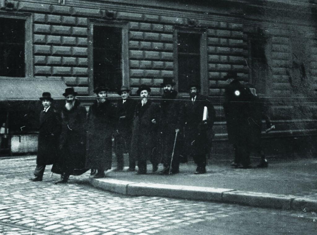 "Harav Avraham Yeshoshua Heschel, the Kopycznitzer Rebbe, zy""a, (third from right) in Vienna."