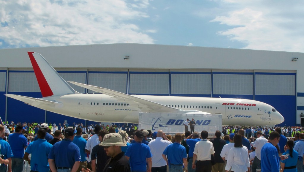 In a Friday, April 27, 2012 photo, Boeing workers gather around the first 787 manufactured at the company's assembly plant in North Charleston, S.C. On Tuesday, the company announced it would invest an additional $1 billion over eight years in its South Carolina operations, creating an additional 2,000 jobs. (AP Photo/Bruce Smith)