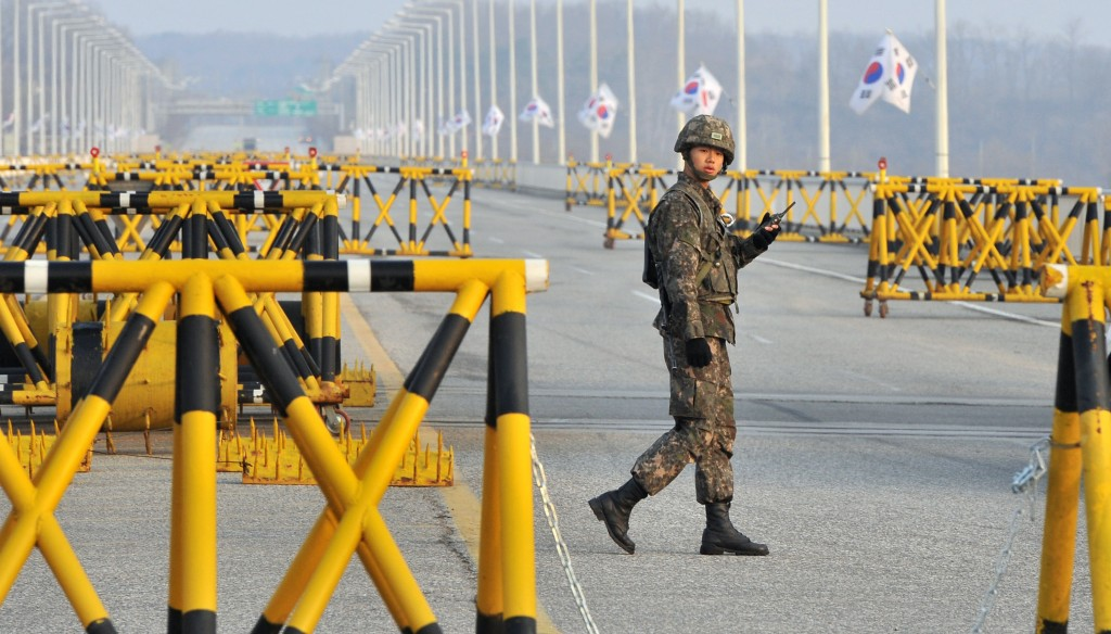 A South Korean soldier walks beside barricades on a road leading to North Korea's Kaesong joint industrial complex, at a military checkpoint in the border city of Paju on Monday. (JUNG YEON-JE/AFP/Getty Images)