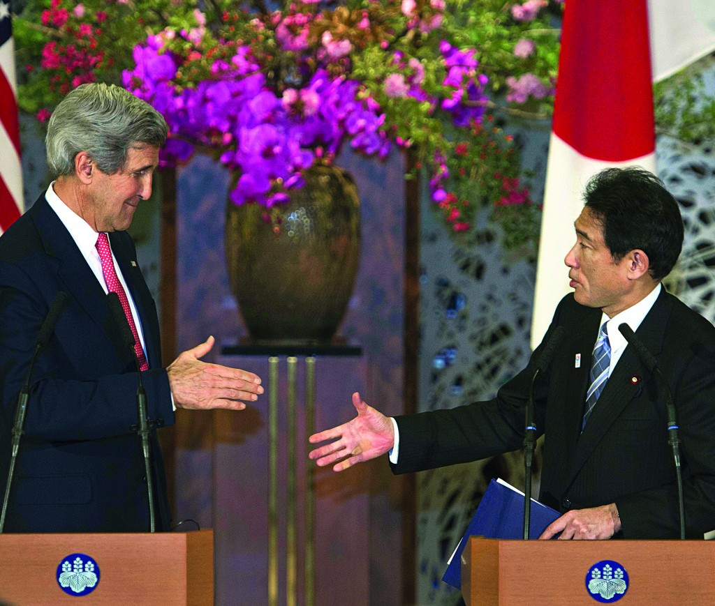Secretary of State John Kerry (L) and Japanese Foreign Minister Fumio Kishida  at the end of their joint press conference in Tokyo on Sunday. (AP Photo/Paul J. Richards, Pool)