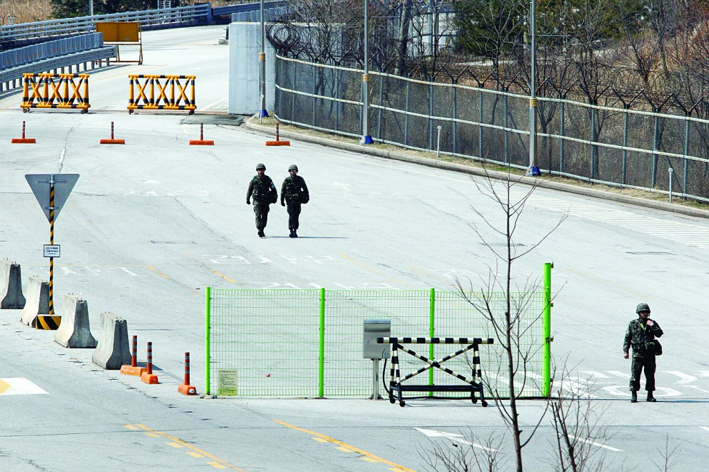 South Korean soldiers walk on the empty road, after South Korean vehicles were refused entry to North Korea at the customs, immigration and quarantine office in Paju, South Korea Wednesday. (AP Photo/Ahn Young-joon)