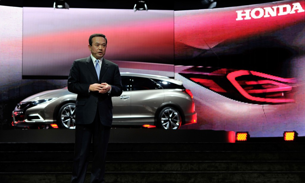Honda Motor Company CEO Takanobu Ito delivers a speech next to the Honda Civic Tourer Concept during the 83rd Geneva Motor Show on March 5, in Geneva, Switzerland. Held annually, the Geneva Motor Show is one of the world's five most important auto shows with this year's event due to unveil more than 130 new products. (Harold Cunningham/Getty Images)