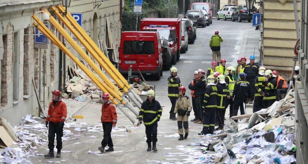 Rescue workers and firefighters search the area after an explosion in Prague, Monday. (REUTERS/Petr Josek)