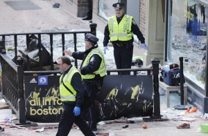 Boston police clear an area following the explosion. (AP Photo/Charles Krupa)