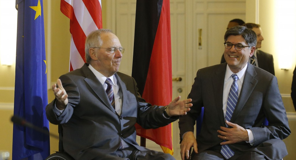German Finance Minister Wolfgang Schaeuble (L) and U.S. Treasury Secretary Jack Lew pose before a news conference after talks in Berlin Tuesday. The United States needs Europe to be economically strong to ensure its own long-term growth, Lew said on Tuesday after talks with Schaeuble. (REUTERS/Tobias Schwarz)