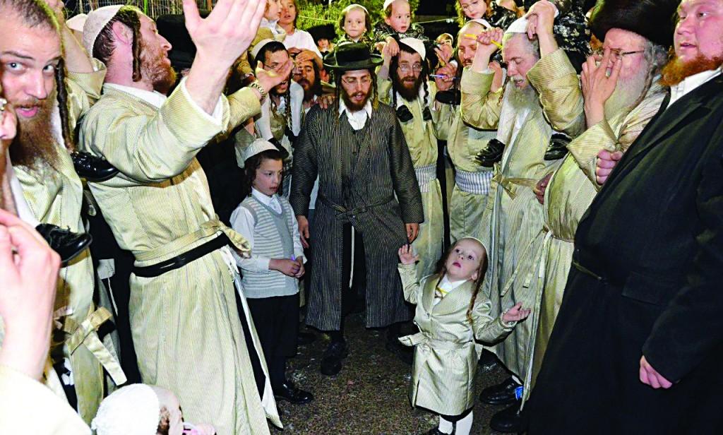 Yidden rejoicing at the tziyun of Rabi Shimon Bar Yochai in Meron on Lag BaOmer.
