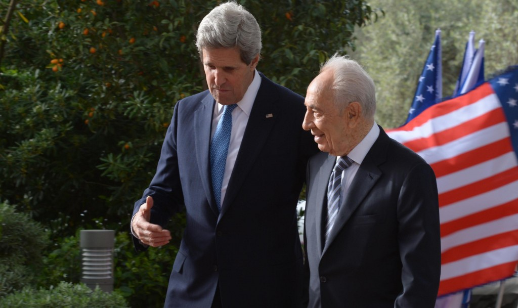 Israel's President Shimon Peres (R) meets with Secretary of State John Kerry at the President's residence on Monday. (FLASH90)