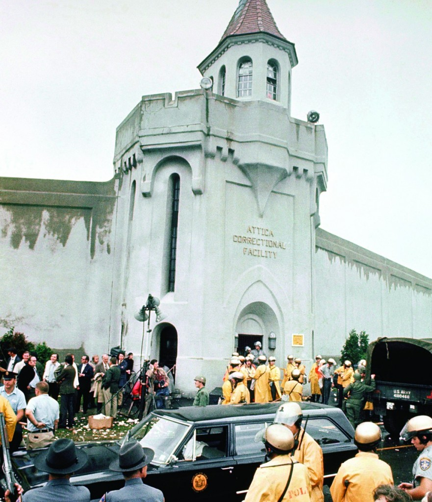 Prison guards and New York State troopers gathered outside Attica State Prison as they prepared to retake it after inmates rioted and held the prison for five days, in Sept. 1971. (AP Photo)