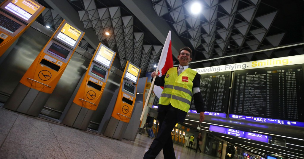 A union member laughs as he arrives for a warning strike of German air carrier Lufthansa's ground personnel at the Fraport airport in Frankfurt, Monday. (REUTERS/Kai Pfaffenbach)