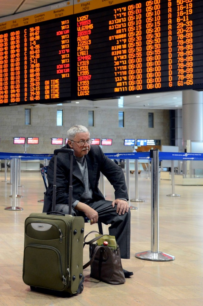 An Israeli traveler waits at the deserted check-in counters in the departure hall at Ben-Gurion International Airport during an airline workers strike. (Flash90)
