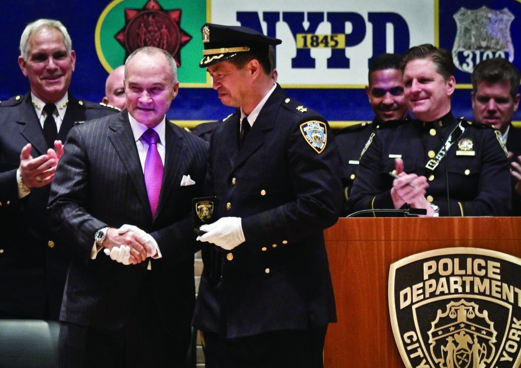 Police Commissioner Ray Kelly (L) greets Chief Thomas Chan (C) after his promotion during a ceremony at police headquarters on Friday. (AP Photo/Bebeto Matthews)