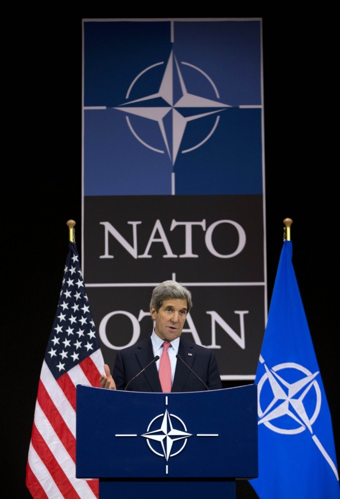 Secretary of State John Kerry gestures during a news conference at the NATO headquarters in Brussels Tuesday. (REUTERS/Evan Vucci/Pool)