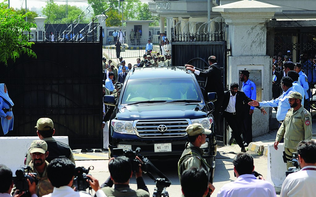 Pakistan's former president and military ruler Pervez Musharraf leaves the High Court in Islamabad, Pakistan, Thursday. Musharraf and his security team pushed past policemen and sped away from court in the country's capital after his bail was revoked in a case in which he is accused of treason. (AP Photo/B.K. Bangash)