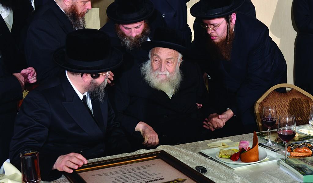 "Rabbi Moshe Zev Feuerstein, z""l, with yblc""t, the Boyaner Rebbe, at the Boyaner dinner in Boro Park two months ago."