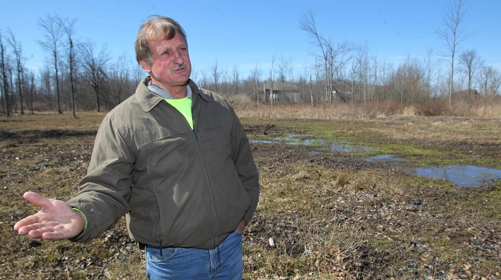 Paul Marinaccio stands on his land in Clarence, N.Y. Saturday. (AP Photo/The Buffalo News, Sharon Cantillon)