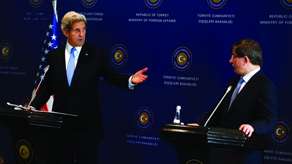 U.S. Secretary of State John Kerry (L) speaks during a joint news conference with Turkey's Foreign Minister Ahmet Davutoglu at Ciragan Palace in Istanbul on Sunday. (REUTERS)